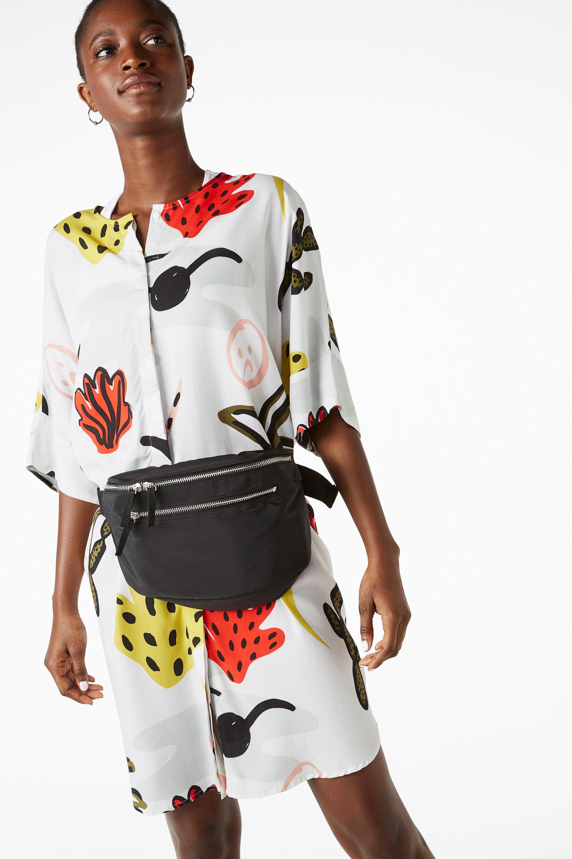 A roomy shirt dress with short sleeves and lotsa little secrets u a