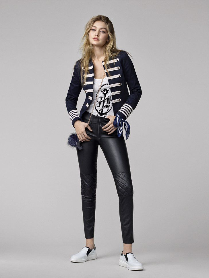 f28ce2848 Pin for Later  Finally  The Gigi Hadid x Tommy Hilfiger Lookbook Is Here  Gigi pairs a military-style blazer with her leather pants.