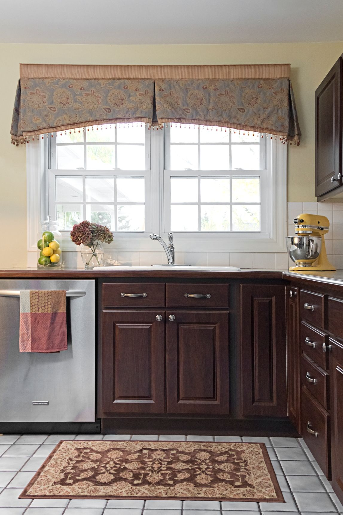 Treating both windows as one. Like the center pleat in middle with ...