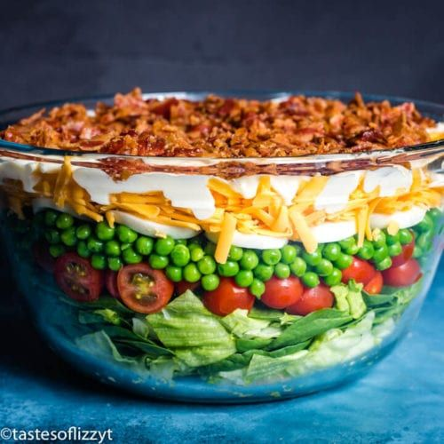 Better than traditional seven layer salad, this easy side dish recipe is high protein since it is l