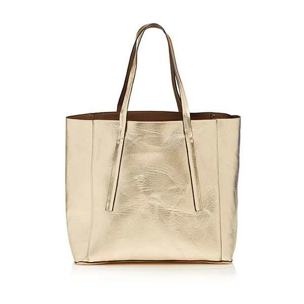 Simons Reversible metallic tote ($39) ❤ liked on Polyvore featuring bags, handbags, tote bags, vegan leather tote, vegan reversible tote, hand bags, handbags totes and purse pouch