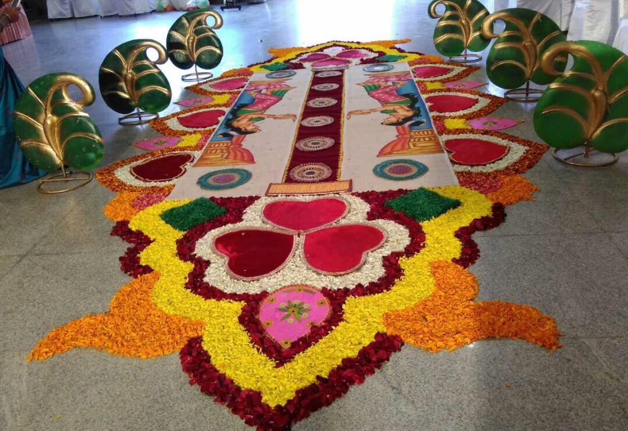 Pin By Greeshma On Flower Rangoli Pookalam Flower Decorations Flower Rangoli Wedding Basket