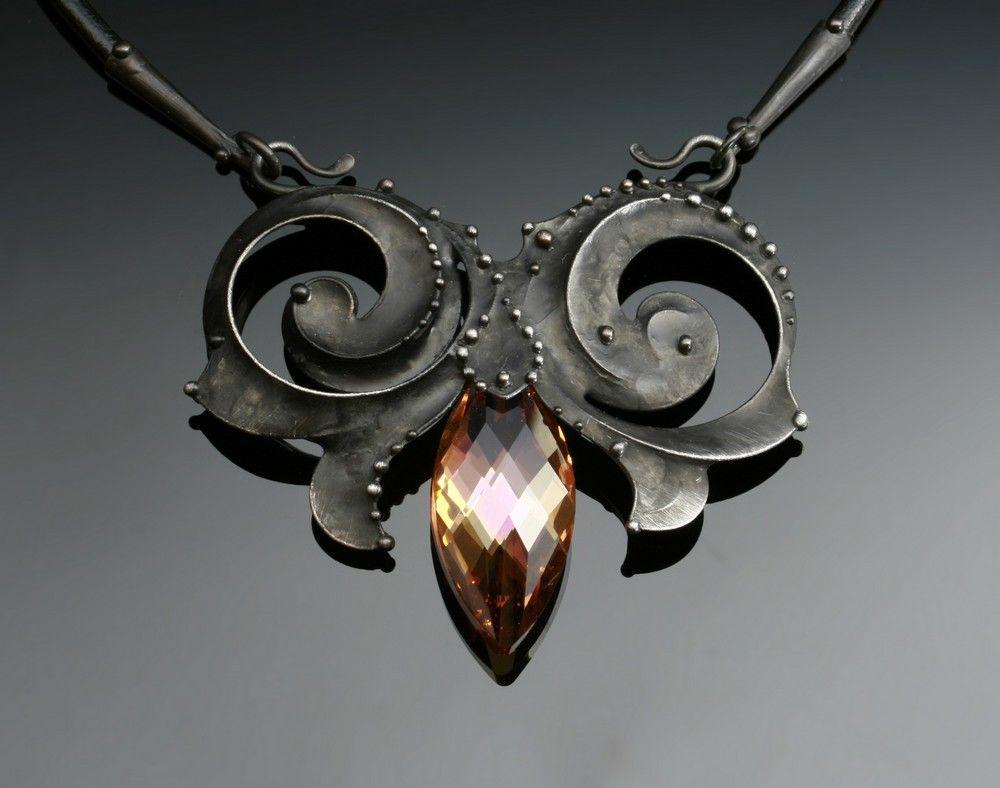 Oliv-Ova necklace: Swarovski crystal, mixed metals,  leather cord.