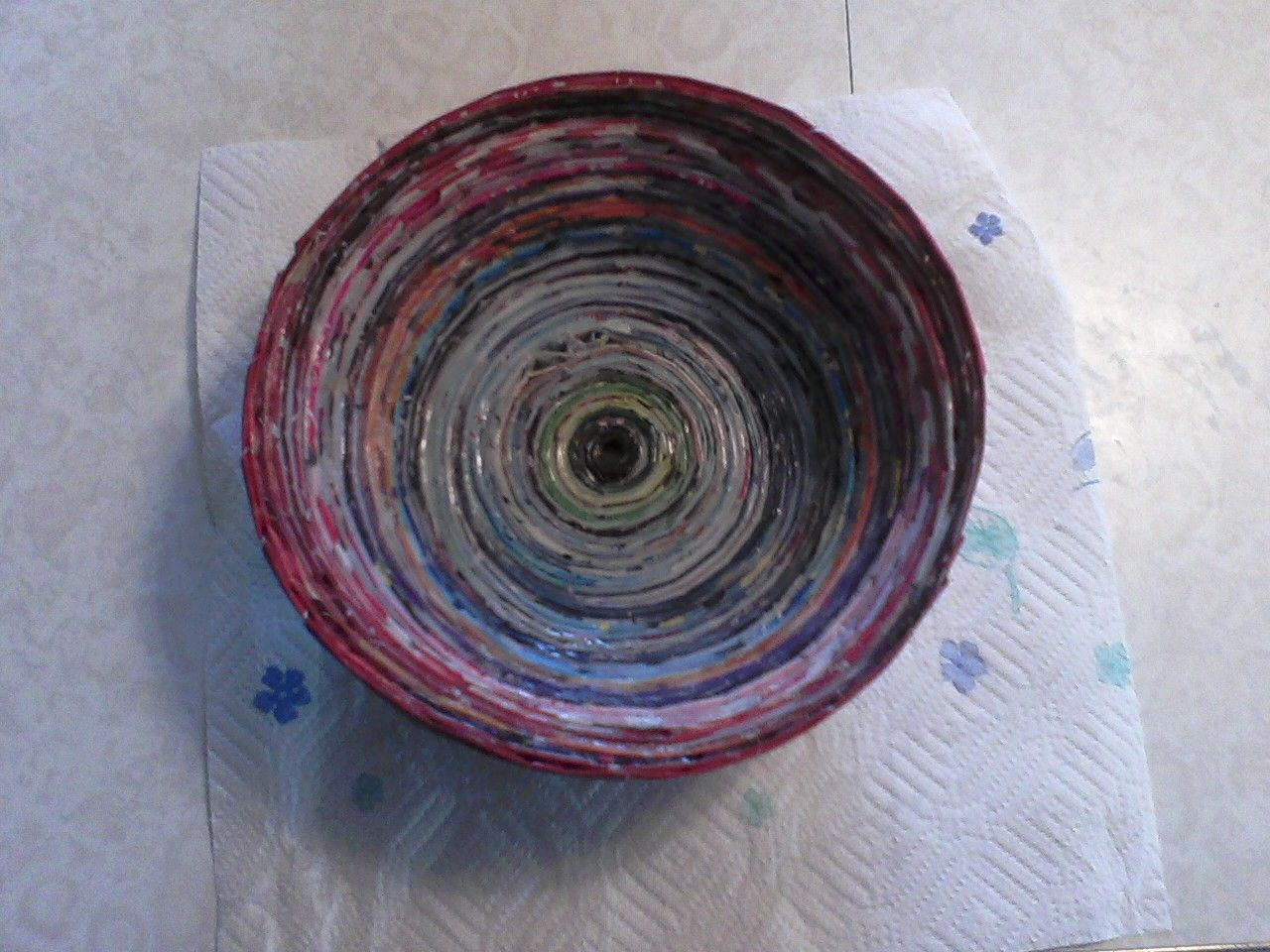 A bowl made out of magazine pages.