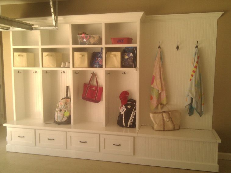 Large white wooden mud room lockers with storage bench with ...