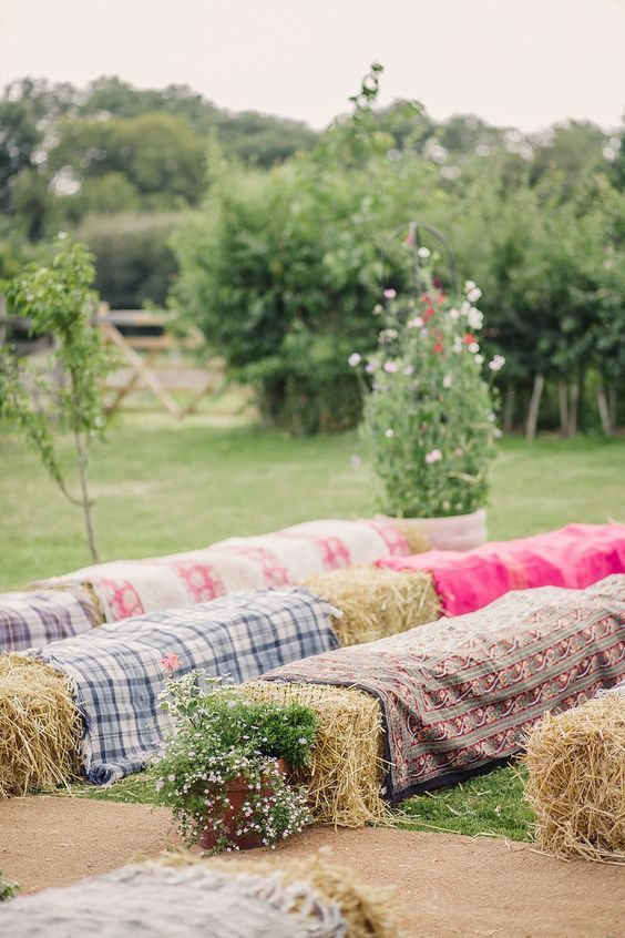 Hay bales as seating for the outdoor wedding ceremony / http://www ...
