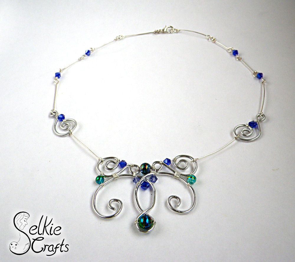 Statement swirls necklace, silver and blue, wire wrapped. Jewellery ...
