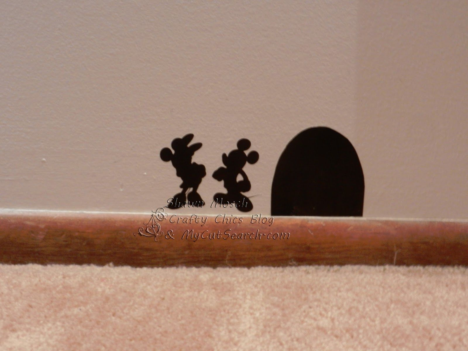 i made a mouse hole with vinyl and added minnie and mickey next to