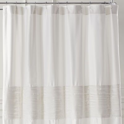 In a calming dose of ivory, our Genevieve polyester matte satin shower curtain has an intricate border pleating for a rich, textural effect. It will add a sophisticated touch of elegance to any bathroom.