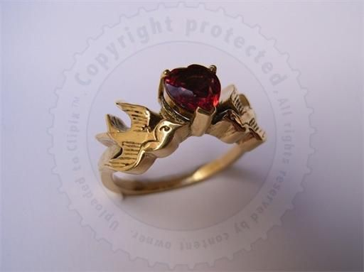 9ct Gold Swallows with Garnet Heart Stone by MetalCoutureJewelry