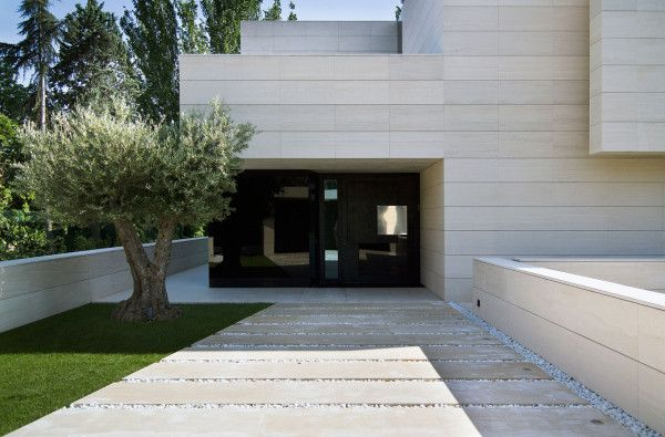 Modern Home Made Of Limestone U0026 Black Glass Design