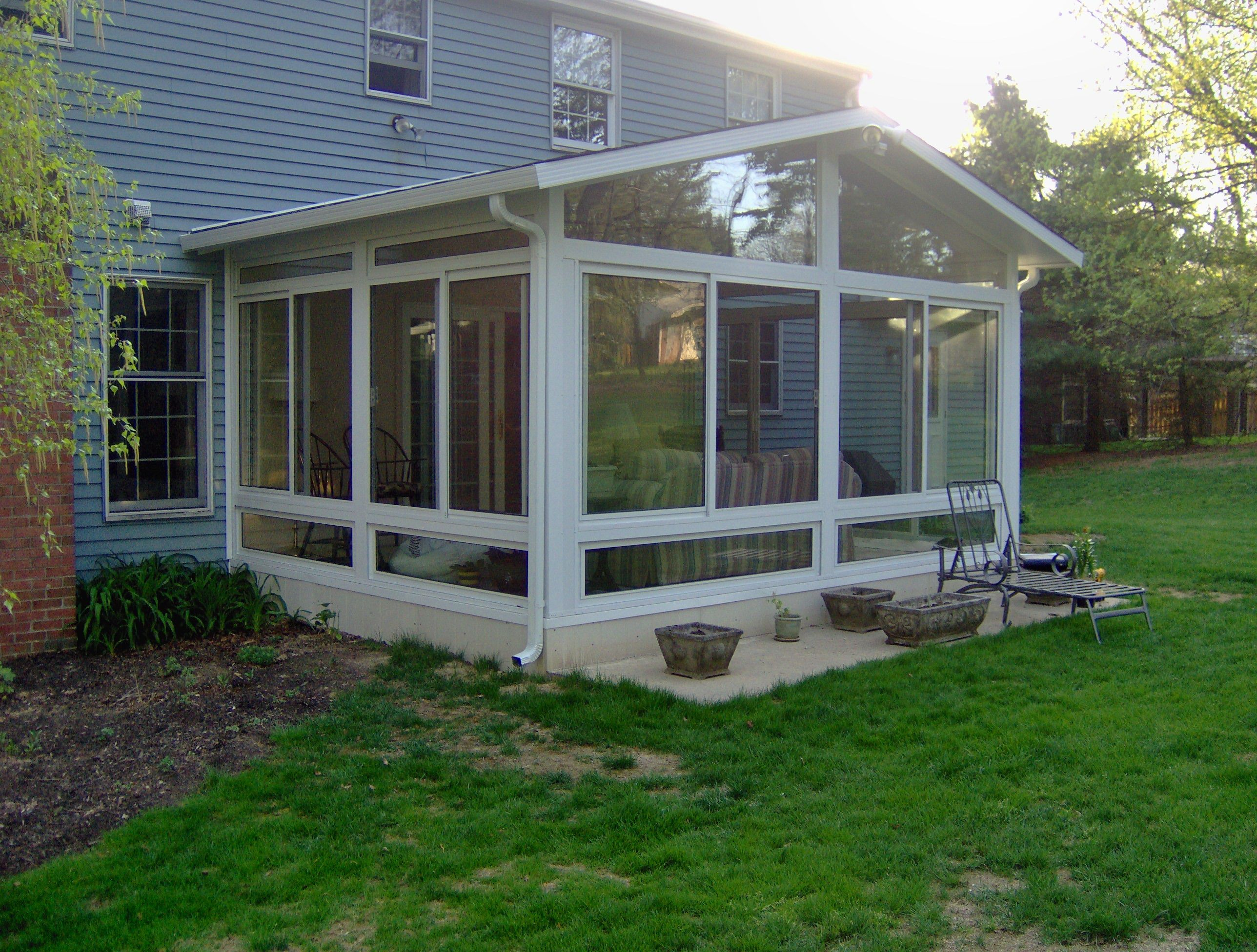 sunroom with gable roof patio room