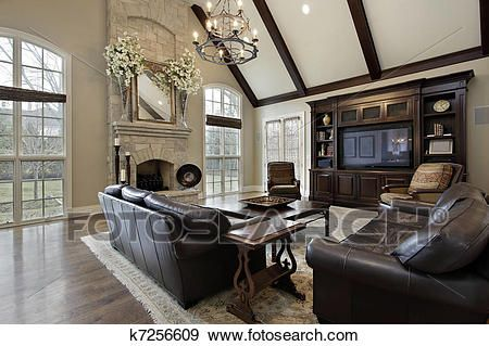 Family room with two story stone fireplace Stock Photo images