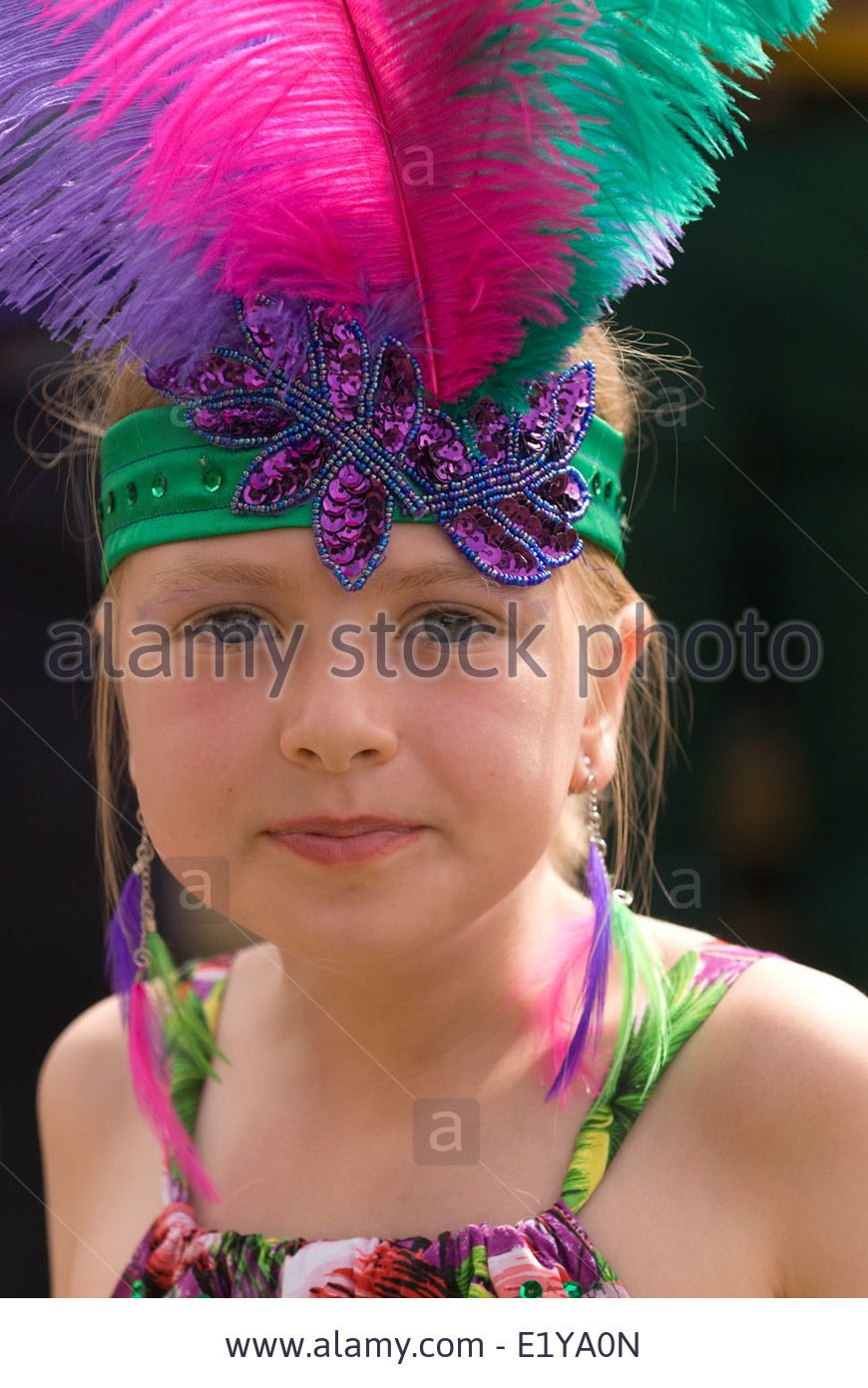 1e756f18e 8 year old girl wearing Brazilian/carnival costume at a village summer fair  which had a Brazil/World Cup 2014 theme... Stock Photo