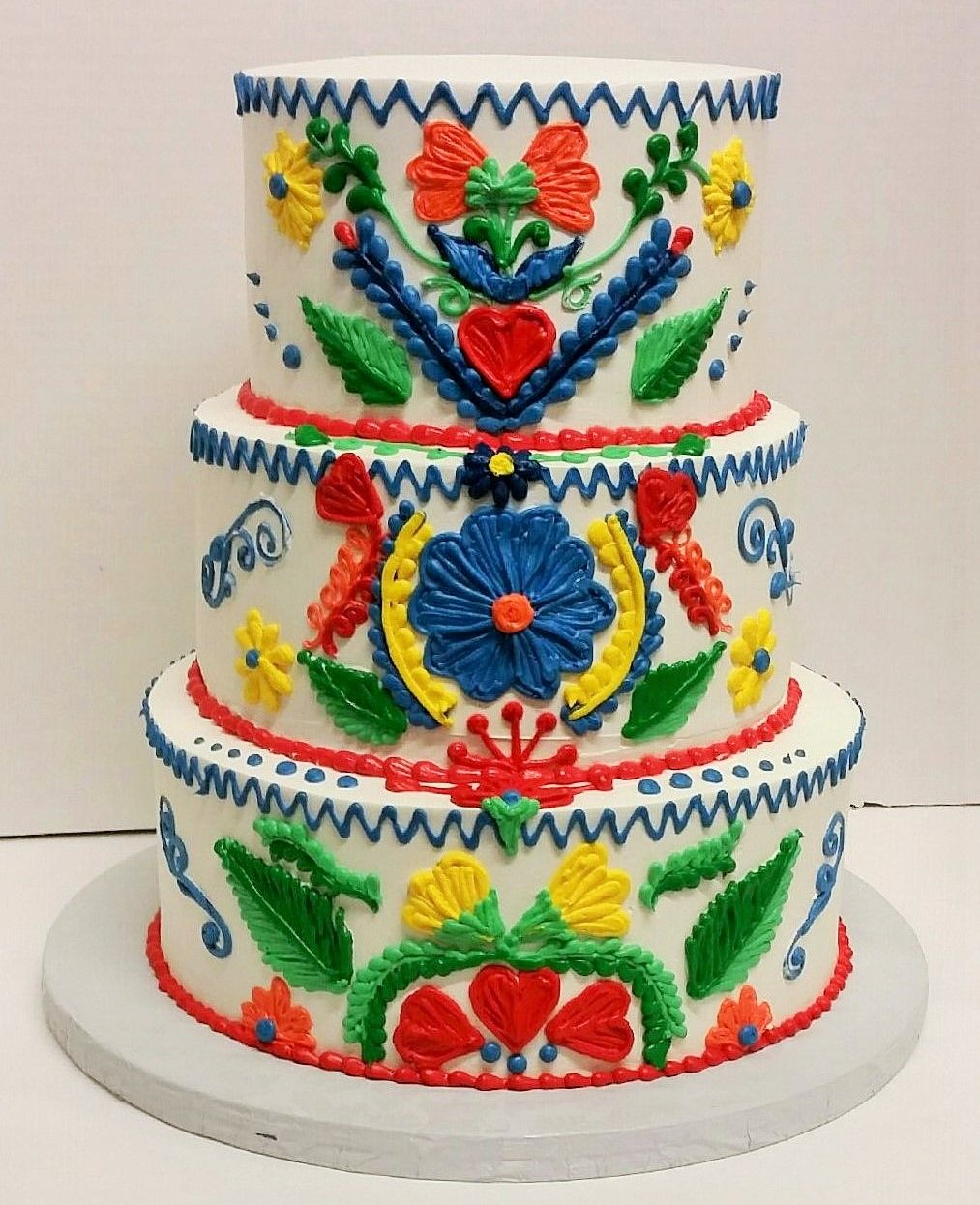 Mexican embroidered themed birthday cake frosted with