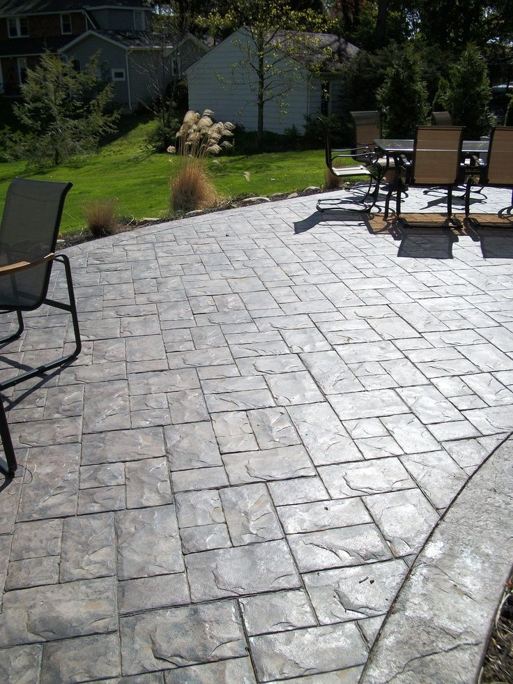 Lovely Patio: Stamped Concrete Patio And Theres A Hole Amid The Terrace With Trees  From Stamped