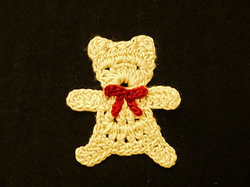 Holiday teddy bear candy cane includes both applique and stitched