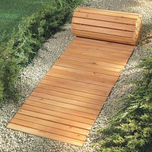 """Eight Foot Wooden Yard Pathway  Wooden Walkway Covers Snowy or Muddy Areas. Roll-out walkway creates an instant path over snow, grass, mud, stones, sand and more! Also great in an outdoor shower, or as an attractive accent in a garden. Pine slats provide sure footing. Rolls up for storage or relocating. 15"""" wide x 8' long. 2 or more $47 each"""