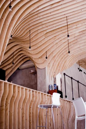 a cafe constructed entirely of plywood ribs codesign business design