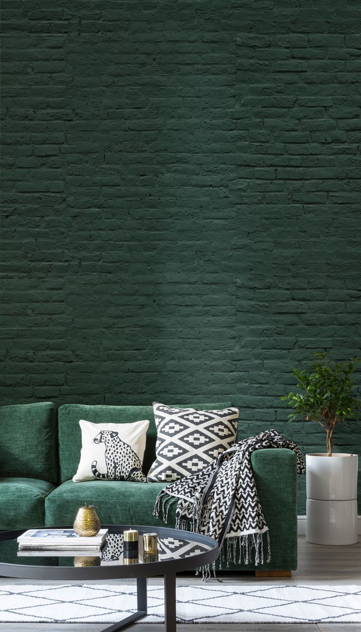 This deep green brick wallpaper follows in the tradition of the rough stripped back scandi look murals wallpapers faux brick effect will add a timeless