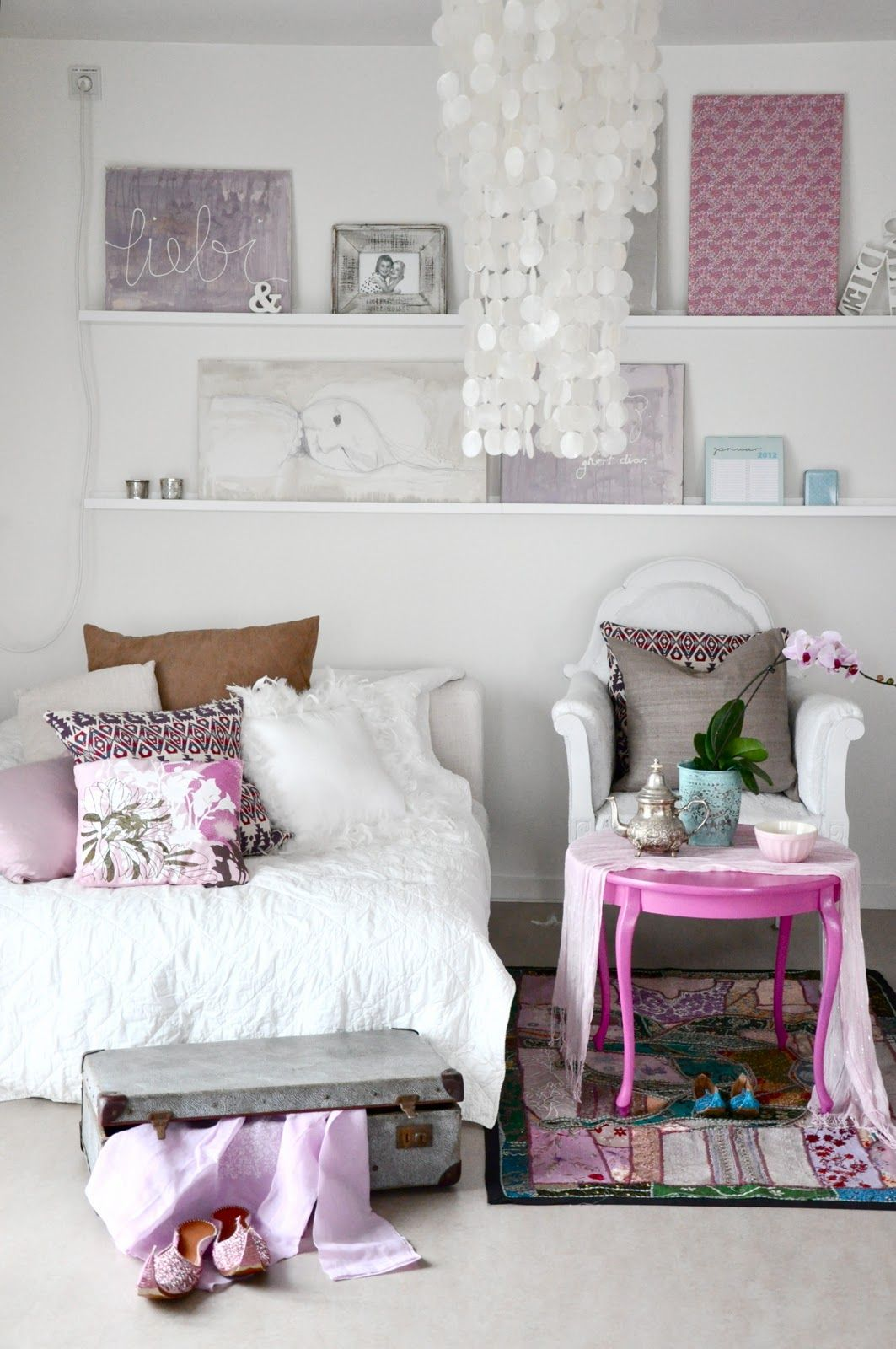 white walls and comforter, pink and purple accents, floating shelves ...