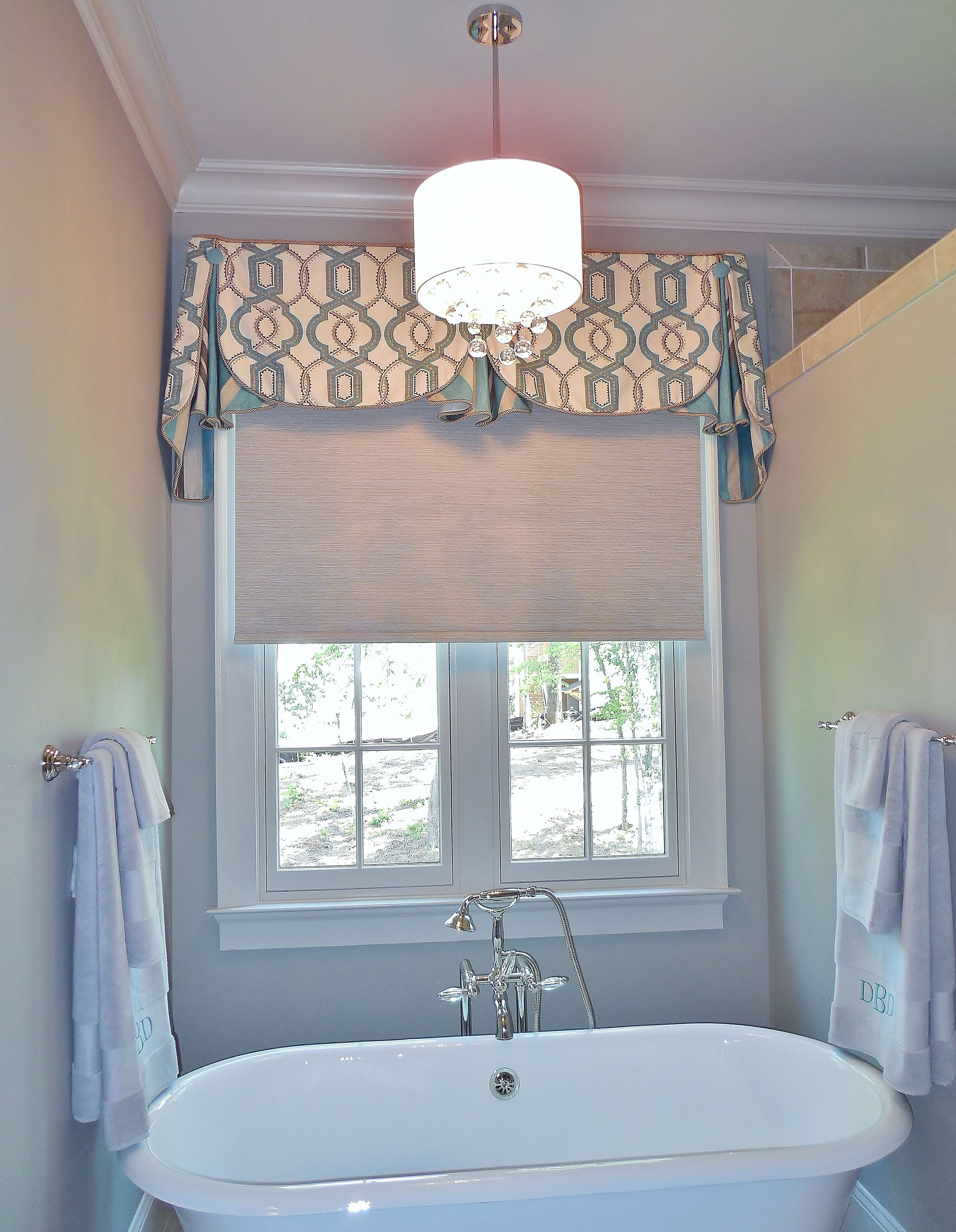 The perfect place for a Motorized Shade is over the tub This one