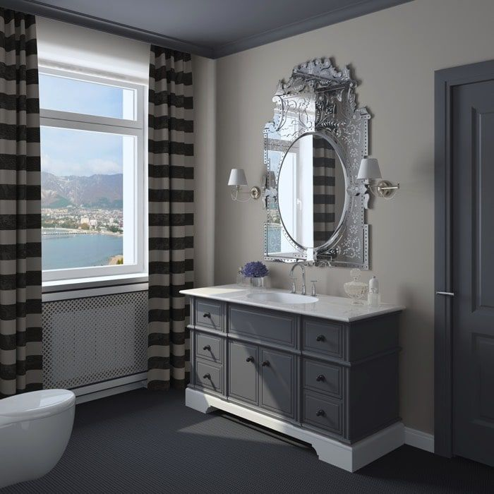 Salle de bain peinte de bleu gris et gris taupe avec son miroir ...