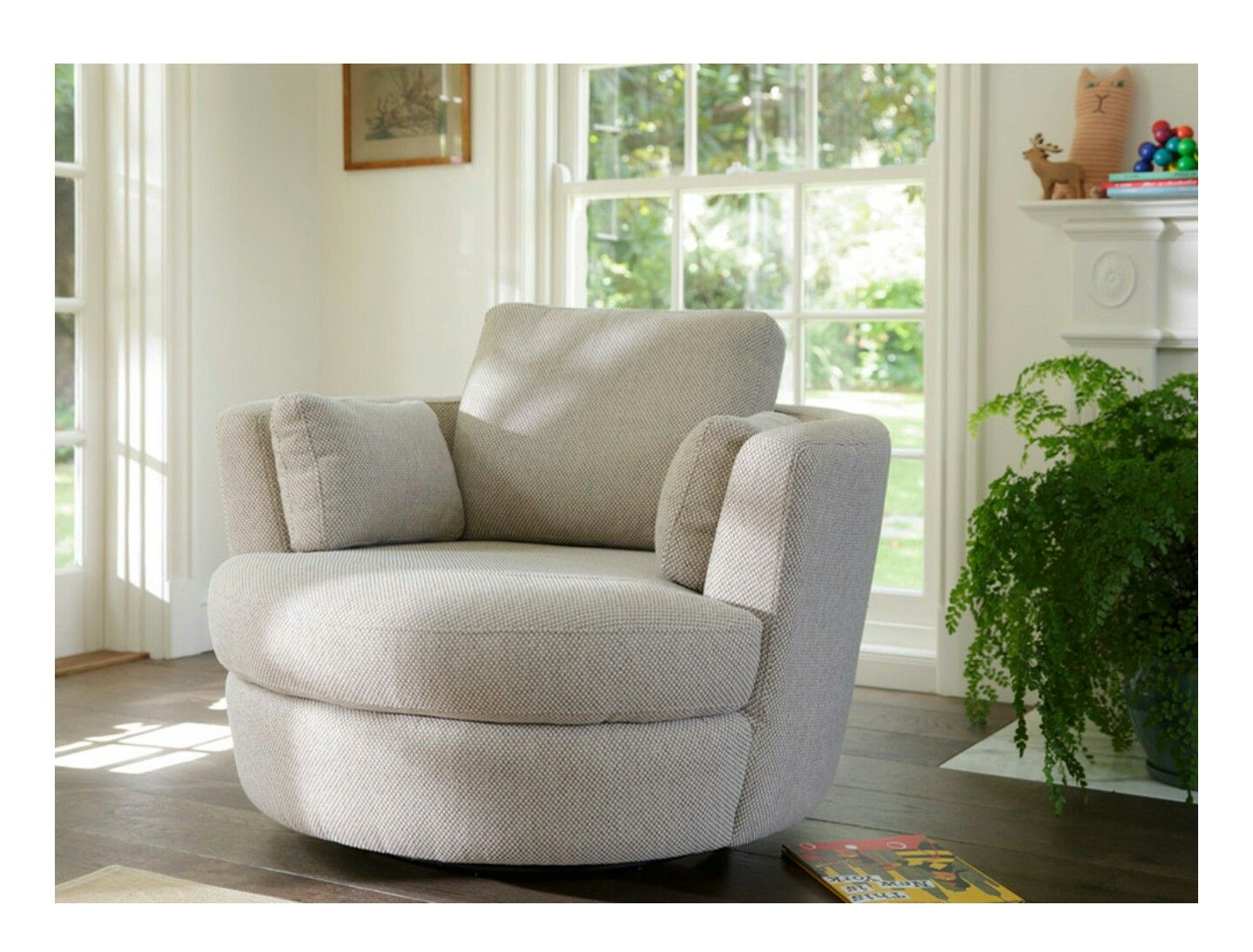Genial Plush Swivel Chair.