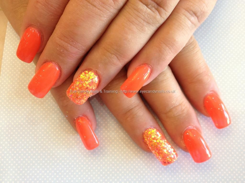Acrylic nails with orange gel polish and glitter dust | Nueva nails ...