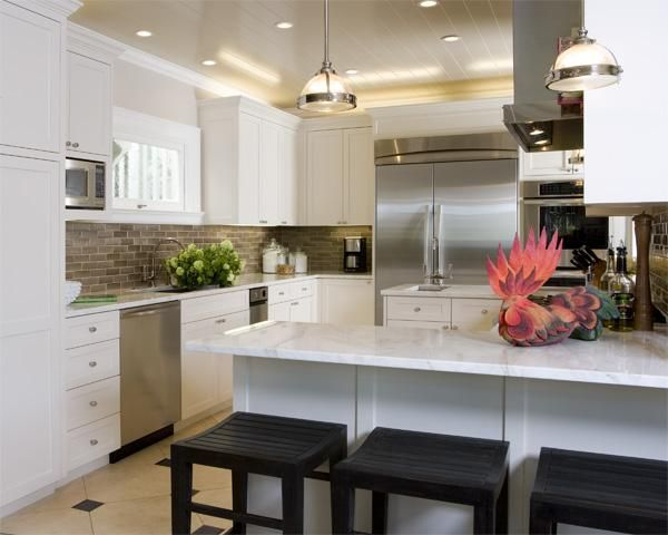Chic Sophisticated White Kitchen Cabinets Calcutta Marble Countertops Beadboard Ceiling Taupe Brown
