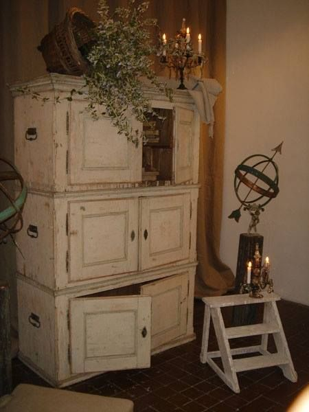 Upper cabinets, stacked and distressed to make a rustic wardrobe