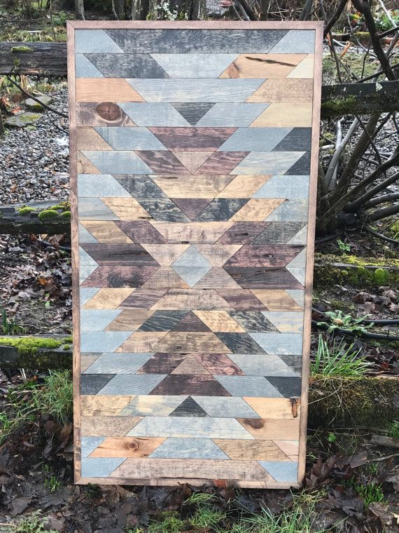 This beautiful tribal print wood wall art is made with pine stained different colors to give it a rustic reclaimed wood look. The colors are quite exquisite together. No two pieces are the same, making this piece completely one of kind. I carefully choose the wood and thoughtfully choose which colors to stain them to give them the most enhancing look possible. This measures 2X4 and it comes with a preinstalled wire for hanging.  **NOTE - This piece is made to order. The picture displayed is…