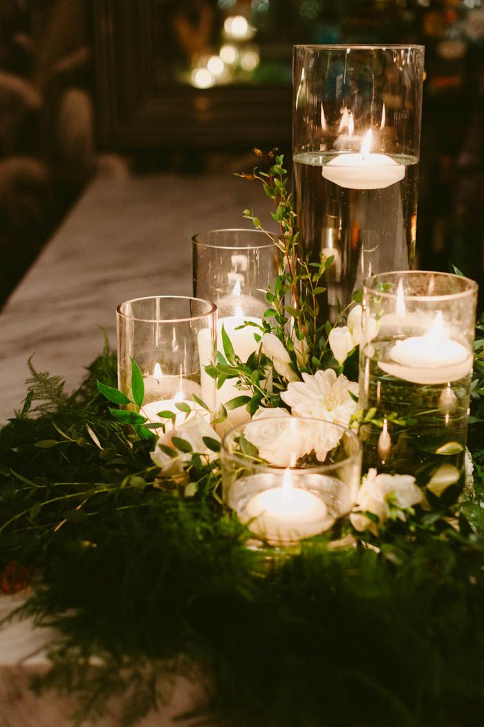 This couple threw an outdoor barbecue wedding in brooklyn at 501 white and green wreath with floating candle centerpiece image by amber gress junglespirit