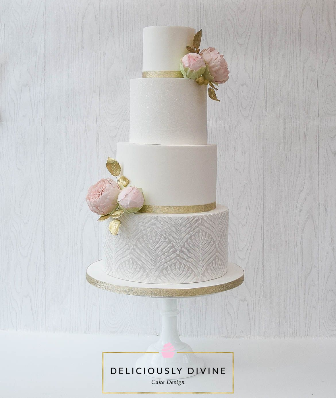 A four tier white, tall, elegant wedding cake with edible glitter ...
