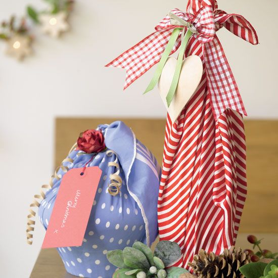 Wrap tricky Christmas gifts with colourful fabric and ribbons