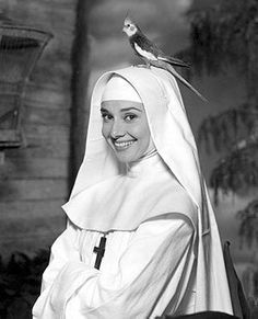 Audrey Hepburn in a Nuns Story. On her had sits a cockatiel. When i was a Little childreen i had a cockatiel.