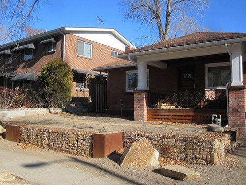 Bungalow house and gabion retaining walls.