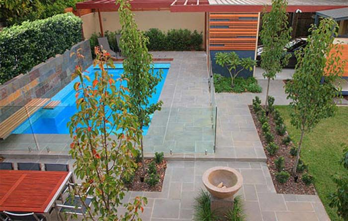 Pool design modern pool landscape design ideas by secret for Landscaping ideas for pool areas