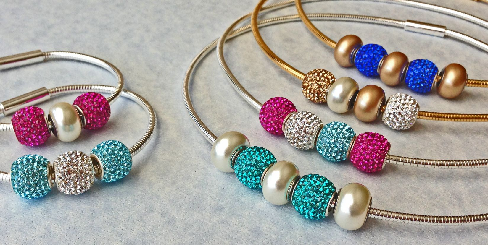 Swarovski crystal studded charms with their pearlized charms are not only stunning but affordable in our necklace and bracelet designs!  Many more coming soon~