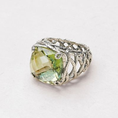 Nestled in an intricately carved sterling silver setting, this 11-carat cushion checkerboard peridot quartz is impossible to ignore. Sizes 5-11. NOTE: Sizes 11, 10, 6, and 5 are special order items. Please allow at least 8 weeks for delivery. Http://donnaaquilino.jewelry.willowhouse.com