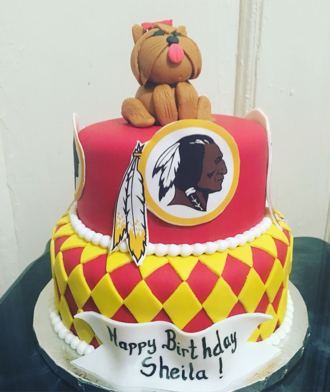 Red skins Indian cake with puppy cake topper!