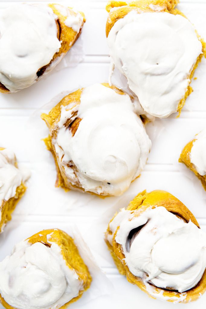 Soft, pillowy pumpkin cinnamon rolls topped with a tangy cream cheese frosting.