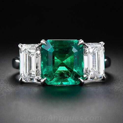 Image from http://www.langantiques.com/images/external/27702/1374100884_30_1_5382_Emerald_and_2.00_Carat_Diamond_Ring__1_of_6_.jpg.