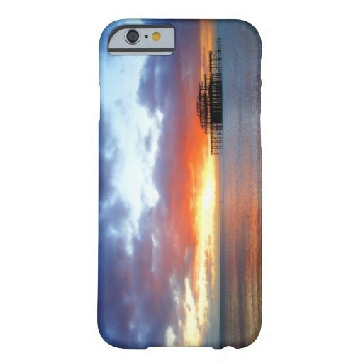A Kiss To Build A Dream On :- Cover for the iPhone 6. A November sunset as seen from Brighton beach on the south coast of England. The skeletal remains of the Victorian West Pier play a supporting role and help make his a truly wonderful and spectacular image. #sunset #sea #ocean #water #channel #beach #pier #decay #ruin #skeletal #rusting #rusted #beautiful #reflection #colorful #england #brighton #sussex #sundown #iphone6