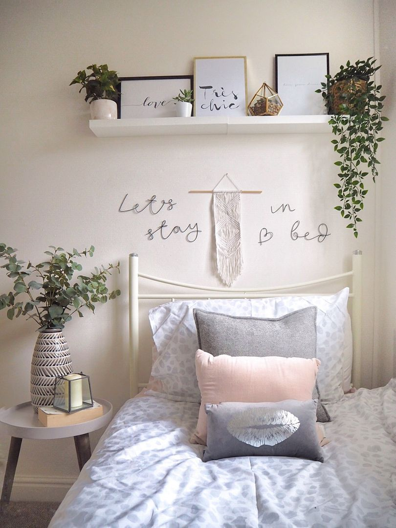 White and grey Scandi bedroom with wire words, macrame