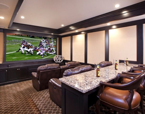 I like the idea of having a bar behind the couch in the media room. Great for watching sports.