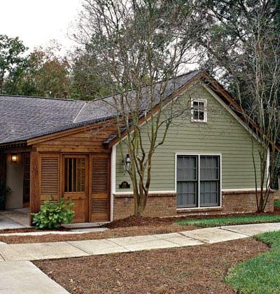 Ranch style home with a charming addition that blocks the for Ranch house garage doors