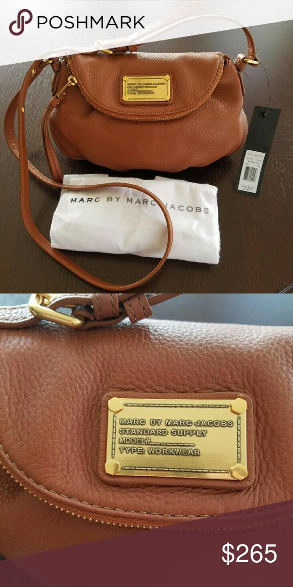 1f86a12f2914 MARC By Marc Jacobs mini Natasha Brand new Marc by Marc Jacobs mini Natasha  leather crossbody handbag. Gorgeous cognac color. Adjustable strap