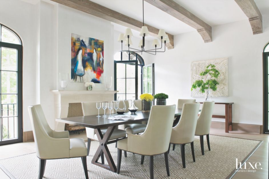 Colorful Artwork Pop in a Neutral Dining Area | LuxeSource | Luxe Magazine - The Luxury Home Redefined