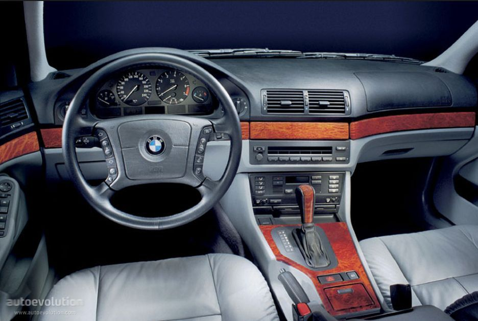 BMW E39 view of stock interior dash and console with gray seats and